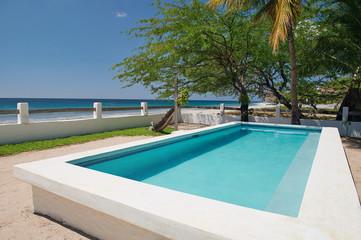 Pool on beach shore