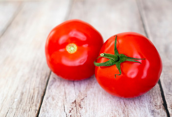 Healthy red fresh tomatoes on wooden board