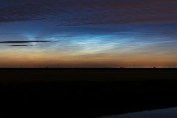 Noctilucent clouds (NLC, night clouds) over the wide open dutch landscape.