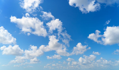Clear blue sky with white fluffy clouds. Nature background