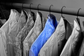 Dress Shirts Hanging on Hangers in Closet