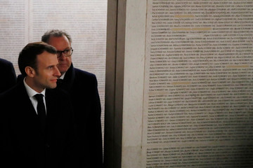 French President Emmanuel Macron pays his respects at the Shoah Memorial in Paris
