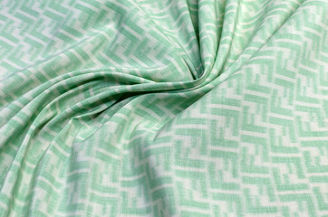 Cotton fabric with silk organza with white and green ornament