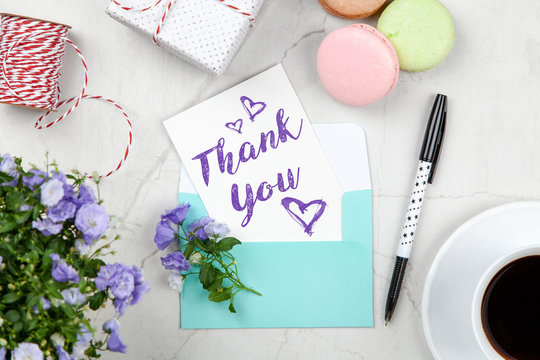 Thank You note on white marble table