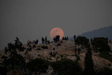 Super snow moon rises over the Acropolis in Athens