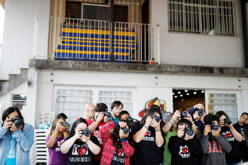 "Students with Down syndrome take pictures during a class at the Galera do Click or ""Click Crowd"", photography school in Sao Paulo"