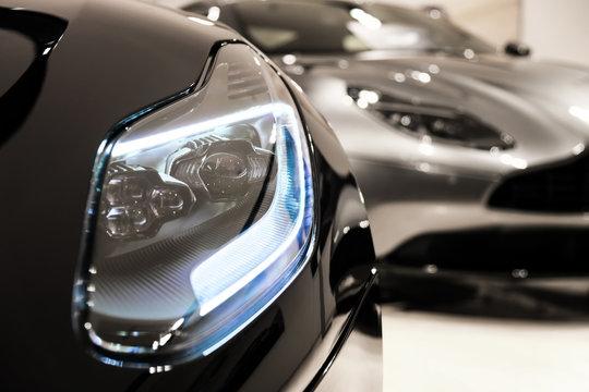 Headlights of sport car at dealer showroom