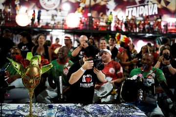 "Student with Down syndrome Bruno Pato takes a picture of members of Mocidade Alegre samba school during a practice of the Galera do Click, or ""Click Crowd"" photography school in Sao Paulo"
