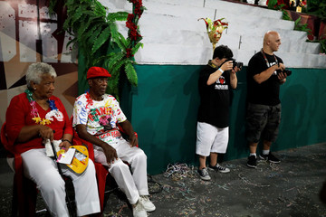 """Students with Down syndrome Felippe and Bruno Pato (2nd R) take a pictures of members of Mocidade Alegre samba school during a practice session of the Galera do Click, or """"Click Crowd"""" photography school in Sao Paulo"""