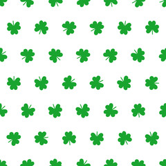Seamless shamrock pattern in white and green.