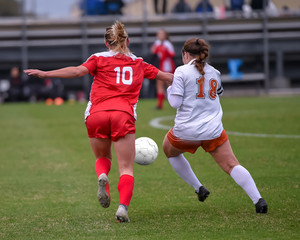 High School girl athletes making amazing plays during a soccer game