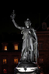 The Marianne statue, national symbol of the French Republic, is seen during a national gathering to protest antisemitism and the rise of anti-Semitic attacks in the Place de la Republique in Paris