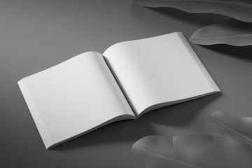Side view of an empty white unfolded book on a black background with tropical flowers. Mock up. 3d rendering