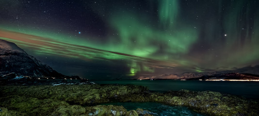 Amazing aurora borealis - northern lights - view from coast in Oldervik, near Tromso city -  north Norway - banner