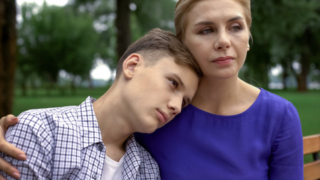 Caring mother supporting teen boy in time of trouble, bullying problem in school