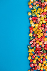 multi-colored popcorn on a bright background.concept of cinema,copy spase