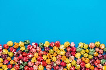 multi-colored popcorn on a bright background.concept of cinema,copy spase