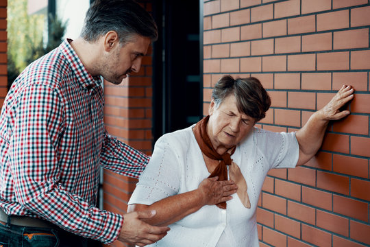 Son trying to help his mother who is having shortness of breath