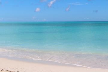 Beach of fine white sand and azure sea. Long Island, Bahamas