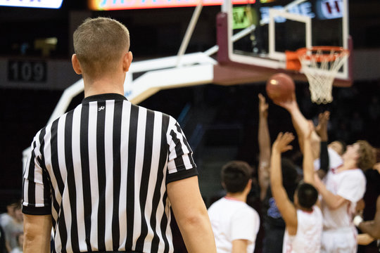 Basketball Sports Referee In Uniform Spotting A Game For A Championship Tournament