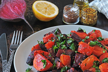 Salad of baked beets, pumpkins and carrots. Warm salad of winter vegetables. Healthy vegan salad with baked vegetables. Beet salad with pumpkin and carrot.