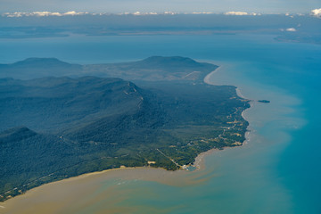 Wall Mural - Flying over Phu Quoc island, Vietnam. Tropical beach ocean landscape. View from airplane window