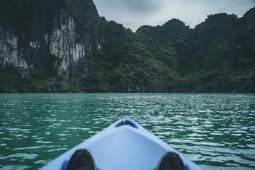 Wall Mural - Kayaking at Ha Long Bay Vietnam. Famous travel nature destination. Green mountains in water landscape at Halong