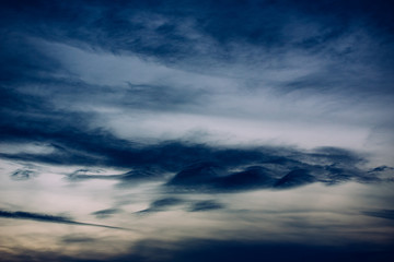 Sky background with curious shapes clouds.