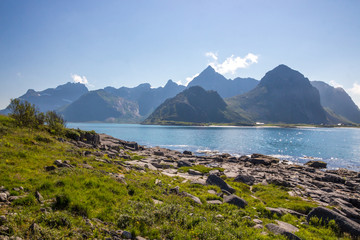 stone beach and mountains in Lofoten in Norway