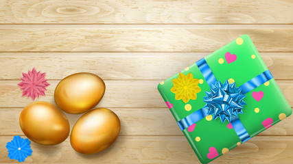 Realistic golden Easter eggs and beautiful gift box with bow on wooden planks