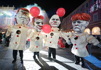 Giant figures of  French President Emmanuel Macron, German Chancellor Angela Merkel, U.S. President Donald Trump and Russian President Vladimir Putin are paraded during the 135th Carnival parade in Nice