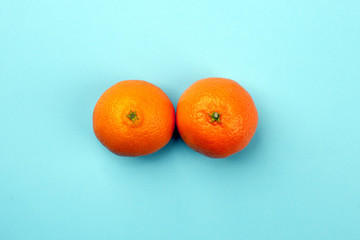 Natural organic exotic citrus fruit as a woman's breast, bust with copy space. Wall mural