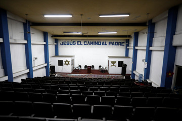 A general view of the screening room of the former Apolo Movie theater, now transformed into a evangelical church, in downtown San Salvador