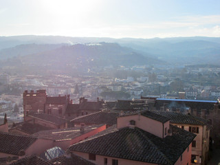 Roofs of little tuscany town Certaldo in morning winter fog, Italy