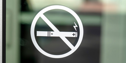 No Smoking sign symbol on a glass surface