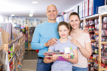 Family in shop of stationery
