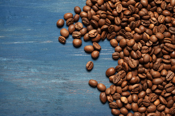 Pile of coffee beans on blue wood