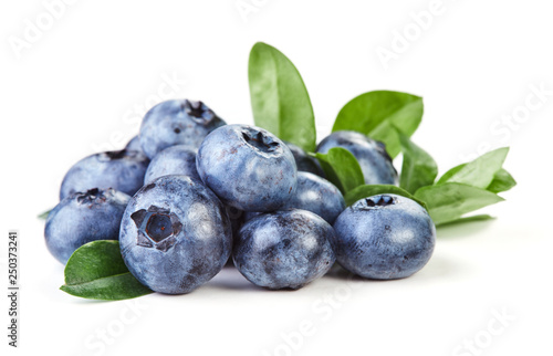 Wall mural blueberries with leaves isolated on white background