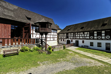 Court of Seeberg castle with barn and timbered building
