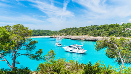 Wall Mural - Landscape with boats and turquoise sea water on Cala Mondrago, Majorca island, Spain