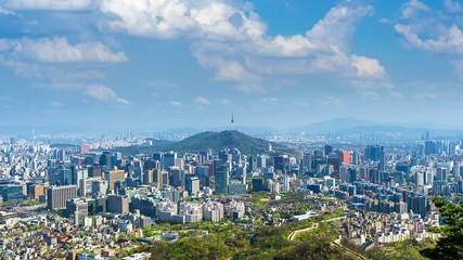 Wall Mural - Time lapse of Cityscape in Seoul with Seoul tower and blue sky, South Korea.