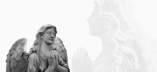 Ancient statue of angel guardian praying. Faith, religion, death, resurrection, theology concept.