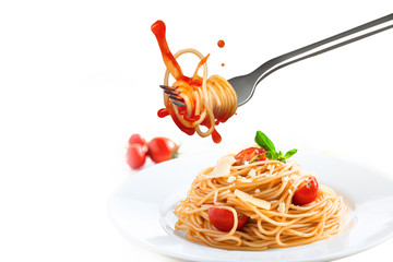Person takes a fork with spaghetti from the plate with pasta and parmesan.