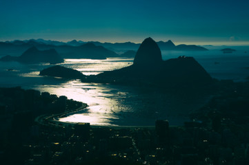 Foto op Canvas Rio de Janeiro Defocused view of scenic moonlit overlook of Rio de Janeiro, Brazil with a skyline silhouette of Sugarloaf Mountain against Guanabara Bay