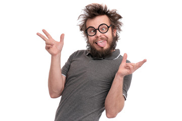 Crazy bearded Man with funny Haircut in eye Glasses making grimace - funny face. Casual Silly guy, isolated on white background. Emotions, and signs concept.