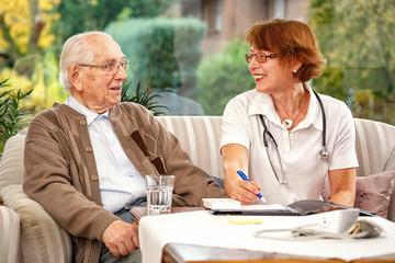Doctor looking after elderly person at home xxl+more: bartussek.xmstore