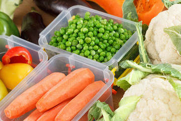 Trays with raw vegetables for freezing.