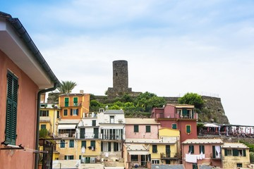 Beautiful small town of Vernazza in the Cinque Terre national Park. View on Vernazza Castello Doria the old fortress and tower at the coastal hill of town Vernazza. Italian colorful landscapes.