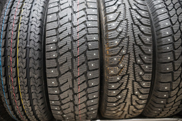 A car shop. Brand new wheels with studded tires