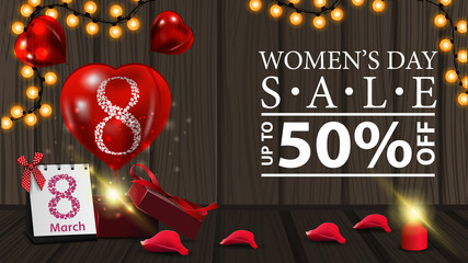 Women's day discount horizontal modern banner on wood background with garland, gift and balloon